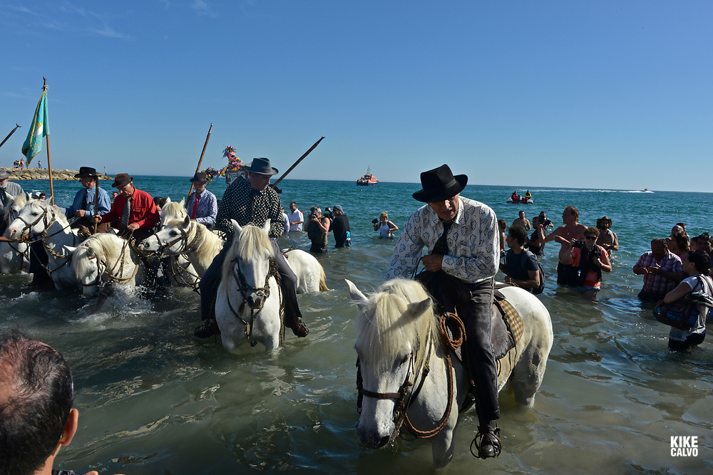 Annual Roma pilgrimage at Saintes-Maries-de-la-Mer. The statue of Sara, carried by the Gypsies to the sea, symbolizes the waiting for and welcome of the Saints Mary Jacobe and Mary Salome. Gardians, the local bull shepherds, wait on horseback for the beginning of the procession and accompany the sculpture of Sara the Black all the way to the sea.