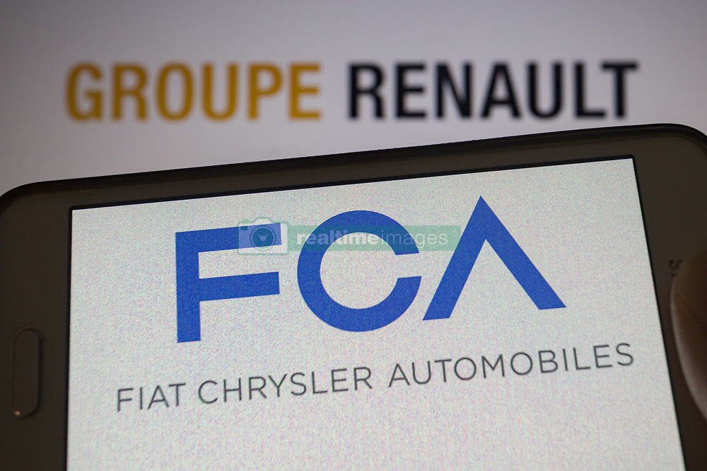 May 26, 2019 - Asuncion, Paraguay - Logo of Fiat Chrysler Automobiles, an Italian-American multinational auto maker, is seen on a smartphone screen against the  logo of Groupe Renault, a French multinational automobile manufacturer, unfocused on background. (Credit Image: © Andre M. Chang/ZUMA Wire)