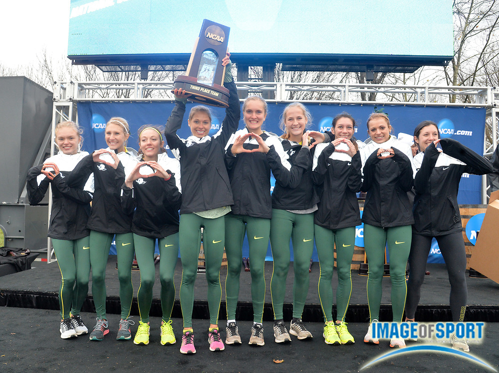 Nov 21, 2015; Louisville, KY, USA; Oregon women and coach Maurica Powell pose after placing third during the 2015 NCAA cross country championships at Tom Sawyer Park.