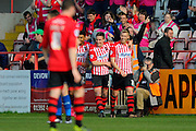 Exeter City's Jayden Stockley celebrates after scoring the opening goal to give the home team a 1-0 lead during the Sky Bet League 2 match between Exeter City and Carlisle United at St James' Park, Exeter, England on 12 March 2016. Photo by Graham Hunt.