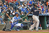 Boston Red Sox designated hitter David Ortiz (34) hits a home run against the Kansas City Royals during the first inning at Kauffman Stadium.