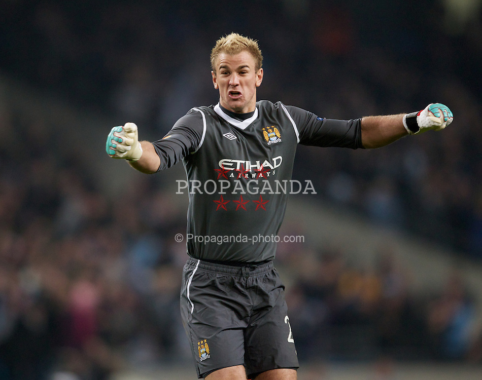 MANCHESTER, ENGLAND - Thursday, March 15, 2012: Manchester City's goalkeeper Joe Hart celebrates his side's third goal against Sporting Clube de Portugal during the UEFA Europa League Round of 16 2nd Leg match at City of Manchester Stadium. (Pic by Vegard Grott/Propaganda)