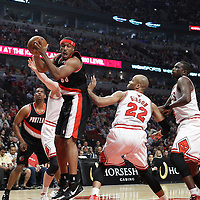 16 March 2012: Portland Trail Blazers power forward Craig Smith (83) grabs an offensive rebound during the Portland Trail Blazers 100-89 victory over the Chicago Bulls at the United Center, Chicago, Illinois, USA.