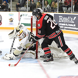 TRENTON, ON - Apr 22, 2016 -  Ontario Junior Hockey League game action between the against the Trenton Golden Hawks and the Georgetown Raiders. Game 5 of the Buckland Cup Championship Series, at the Duncan Memorial Gardens in Trenton, Ontario. Daniel Urbani #30 of the Trenton Golden Hawks keeps the puck from Josh Dickinson #28 of the Georgetown Raiders during the first period.<br /> (Photo by Andy Corneau / OJHL Images)