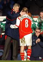 Photo: Javier Garcia/Back Page Images<br />Arsenal v Fulham, FA Barclays Premiership, Highbury, 26/12/04<br />A happy Arsene Wenger substitutes Freddie Ljungberg after his recent health scare