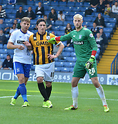 a tussle in the area before a corner kick during the Sky Bet League 1 match between Bury and Port Vale at Gigg Lane, Bury, England on 19 September 2015. Photo by Mark Pollitt.