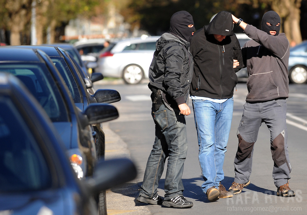 An unidentified suspect of being a member of pro-independence young Basque association SEGI arrives at the Spanish National Police headquarters after his arrest, on November 24, 2009, in the northern Spanish Basque city of San Sebastian. 36 people were arrested by Spanish National Police during an anti-terrorist operation, in the Basque Country and Navarra, ordered by Spanish judge Grande Marlaska. PHOTO/Rafa Rivas