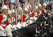 As the Queen celebrates her 84th official birthday with Trooping the Colour, thousands of spectators gather to watch the traditional annual display of military pomp and pageantry. The celebration ended with a 30 plane fly past including the red arrows, on The Mall, central London......