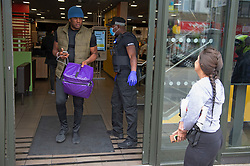 ©Licensed to London News Pictures 13/05/2020<br /> Welling, UK. A delivery man heading out. Welling McDonalds in South East London has queues of food delivery drivers outside waiting. Some McDonalds restaurants in the UK have opened today from 11am for McDelivery service only after being closed for weeks due to the Coronavirus lockdown. Photo credit: Grant Falvey/LNP