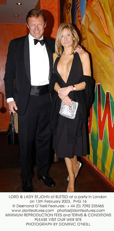 LORD & LADY ST.JOHN of BLETSO at a party in London on 13th February 2003.<br />
