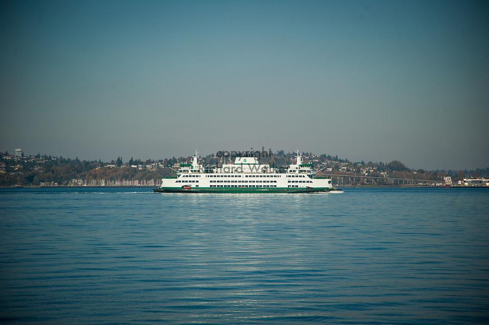 2017 NOVEMBER 06 - Washington State Ferry in Elliott Bay with Magnolia in background, Seattle, WA, USA. By Richard Walker
