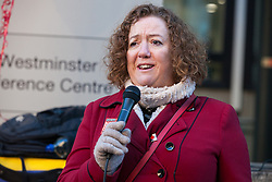 London, UK. 14th February, 2019. Fran Heathcote (President of the DWP group of PCS) shows solidarity on a Valentine's Day-themed picket line outside the Department of Business, Energy and Industrial Strategy (BEIS) with outsourced support staff from the Public and Commercial Services (PCS) union taking strike action to demand the London Living Wage and an end to outsourcing.