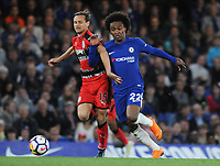 Football - 2017 / 2018 Premier League - Chelsea vs. Huddersfield Town<br /> <br /> Chris Lowe of Huddersfield Town challenges Willian, at Stamford Bridge.<br /> <br /> COLORSPORT/ANDREW COWIE