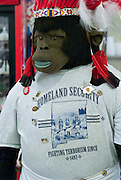 Ape doll dressed in Homeland Securtiy shirt..