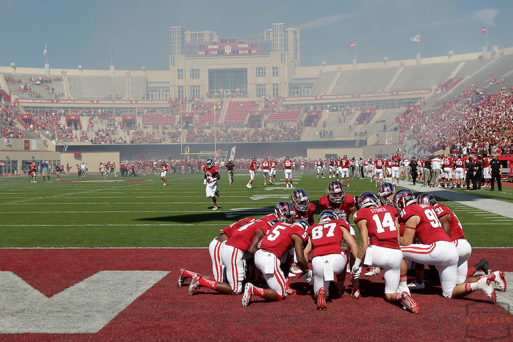 27 September 2014: Memebers of the indiana team pray before  the Indiana Hoosiers played Maryland in a college football game in Bloomington, IN.