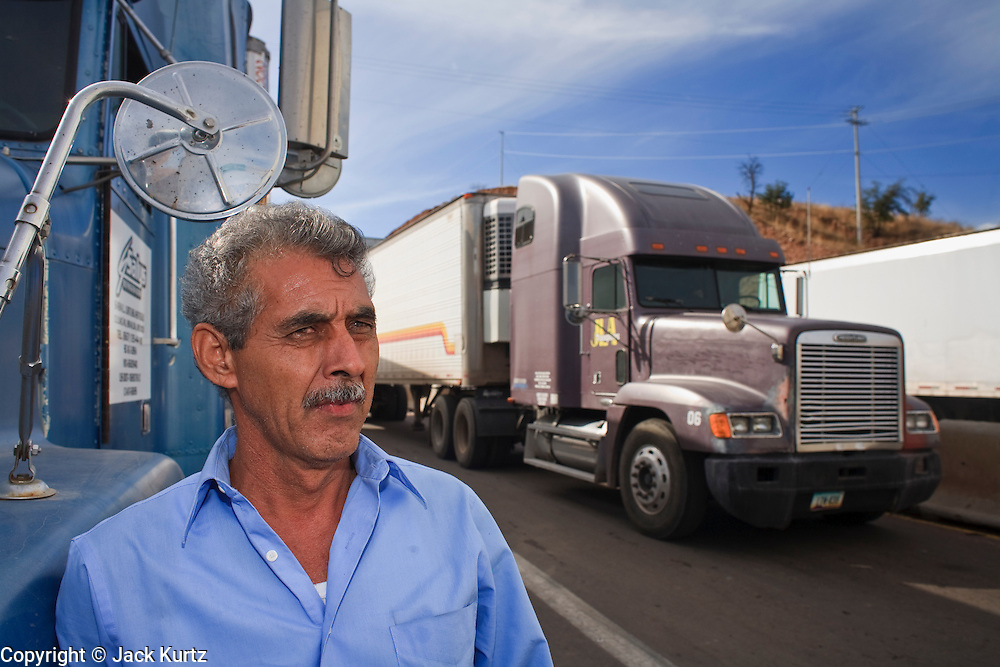 19 DECEMBER 2008 -- NOGALES, SON, MEX: Rafael Iribe, a Mexican trucker, waits to enter the US on the Mexican side of the Mariposa port of Entry in Nogales. PHOTO BY JACK KURTZ