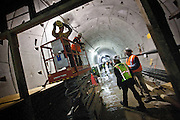 Construction workers inside a subway tunnel being built as part of the extension of the 7 line of the New York subway system. The tunnel and the 34th street station is well on its way to be finished. A proposed extension to New Jersey is in the talks.