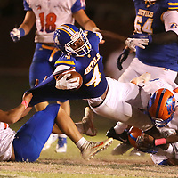 Booneville's Dallas Gamble reaches for more yards as he is stopped by the North Pontotoc defense in the second quarter.