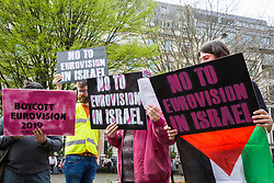 London, UK. 30th March, 2019. Activists from London Palestine Action sing reworded Eurovision songs at a protest outside the offices of Bauer Media, home of Magic FM, to call on Mel Giedroyc, who has a Saturday radio show on Magic FM, to withdraw from hosting Eurovision 2019 in Tel Aviv in recognition of the Palestinian call for a cultural boycott of Israel and in order not to assist with the 'culturewashing' of Israeli human rights abuses.