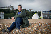 Turner Prize nominated Lubaina Himid MBE during the construction of her Jelly Mould Pavilion on Folkestone's sea front as part of the 2017 Folkestone Triennial. Folkestone, Kent. Lubaina Himid created a Jelly Mould Pavilion on Folkestone's sea front, on the former 'Rotunda' site of the town's fun fair, Lido and amusement park where the sugar of candy floss and toffee apples fuelled summer visitors. The pavilion's colourful decoration in the artist's signature patterning will serve as a reminder of the lost amusement park, as well as providing a beautiful shelter at the edge of the town to rest, look out to sea, and think about the role of sugar in Britain's history. Folkestone, Kent.<br /> (photo by Andrew Aitchison / In pictures via Getty Images)