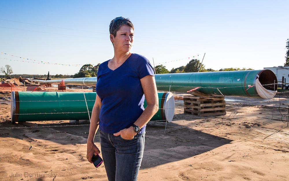 October 14th, Sumner Texas, Julia Trigg Crawford across from her farm looking at a TransCanada Keystone Pipeline consturction site. She  been battling against TransCanada to stop them from using her land to run the Keystone pipeline through by bringing a case against them for improper use of the eminant domain law.