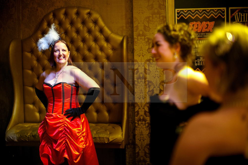 © Licensed to London News Pictures. 13/02/2016. London, UK. Participants getting ready to take part at world's largest burlesque glove peel relay record attempt at Clapham Grand in London on Saturday, 13 February 2016. Organised by Sapphira, founder of a burlesque academy, the event is a tribute to Sir Richard Branson after they were given discount on their flights to tour from Australia to England. Photo credit: Tolga Akmen/LNP