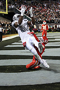 Oakland Raiders tight end Jared Cook (87) reaches for the ball but is unable to catch an end zone pass while covered by a falling down defender during the 2017 NFL week 7 regular season football game against the against the Kansas City Chiefs, Thursday, Oct. 19, 2017 in Oakland, Calif. The Raiders won the game 31-30. (©Paul Anthony Spinelli)