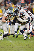 SAN DIEGO - DECEMBER 5:  Linebacker Randall Godfrey #58 of the San Diego Chargers tackles running back Reuben Droughns #34 of the Denver Broncos on December 5, 2004 at Qualcomm Stadium in San Diego, California. The Chargers defeated the Broncos 20-17. ©Paul Anthony Spinelli *** Local Caption *** Randall Godfrey;Reuben Droughns