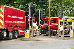 A articulated lorry tipped over under the bridge approaching the Old Dalkeith Road near the Cameron Toll shopping centre Edinburgh this morning. The emergency services were on hand very quickly and were working on how best to resue the driver. He appeared to be uninjured but trapped due to the angle  the vechicle ended up in. 18 June 2014 (c) GER HARLEY | StockPix.eu