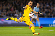 Melbourne City goalkeeper Eugene Galekovic (18) kicks the ball away at the Hyundai A-League Round 1 soccer match between Melbourne Victory and Melbourne City FC at Marvel Stadium in Melbourne.
