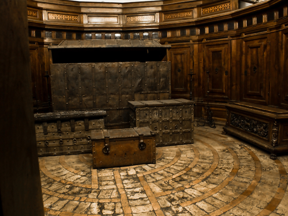 Castel Sant'Angelo, shipping trunks and chests in an upper room of Pope Paul 3d; an interior of polished wood panels on walls and floor.