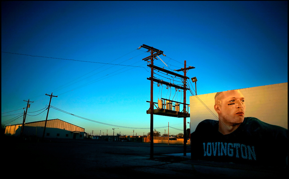 Brian Urlacher's success as an All Pro linebacker who has made it to the Super Bowl provides a charge of pride and enthusiasm for the residents of his struggling hometown of Lovington. Nike paid for this mural, depicting Urlacher in his high school uniform, which covers the side of a vacated building on South Main Street in Lovington.