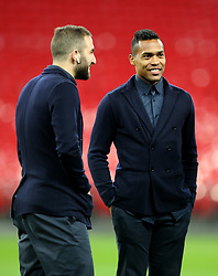 Juventus Alex Sandro (right) and Gonzalo Higuain on the pitch before the press conference at Wembley Stadium, London.