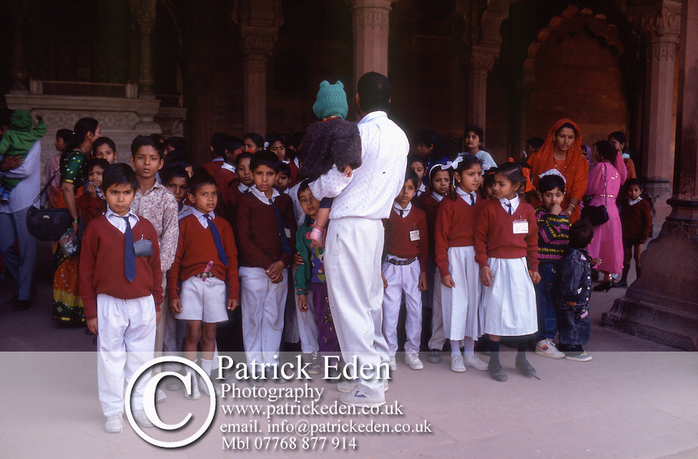 School Children, The Lal Qila, Red Fort, Delhi, India, Groups of smartly dressed kids are seen at every historical site. History is very important in Schools. photograph photography