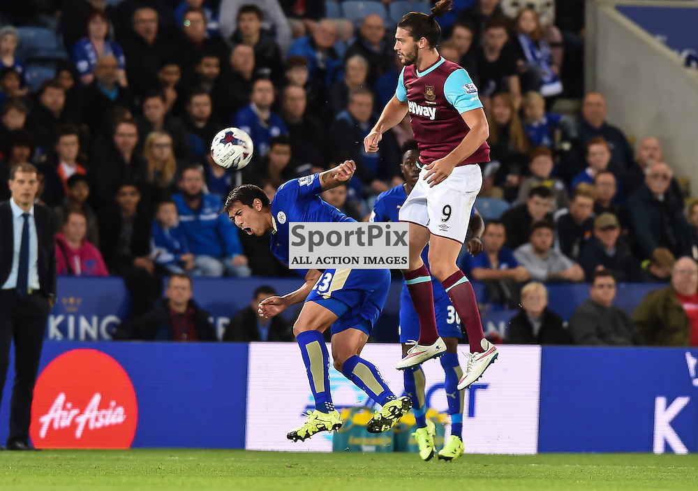 Andy Carroll clatters in to Leonardo Ulloa as he contests a high ball (c) Simon Kimber | SportPix.org.uk