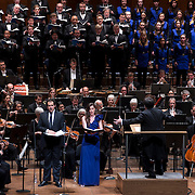 """November 21, 2013 - New York, NY :  Conductor Alan Gilbert, on podium, leads the New York Philharmonic, the New York Choral Artists, and the Brooklyn Youth Chorus, along with vocal soloists, standing from left, tenor Dominic Armstrong (in tie), soprano Kate Royal (in violet dress), and mezzo-soprano Sasha Cooke (in sequined dress) in Bejamin Britten's """"Spring Symphony, Op. 44 (1948-49)"""" with the New York Philharmonic at Avery Fisher Hall at Lincoln Center on Thursday night. Armstrong made his NY Phil debut as a last-minute substitution for tenor Paul Appleby, who withdrew due to illness. CREDIT: Karsten Moran for The New York Times"""