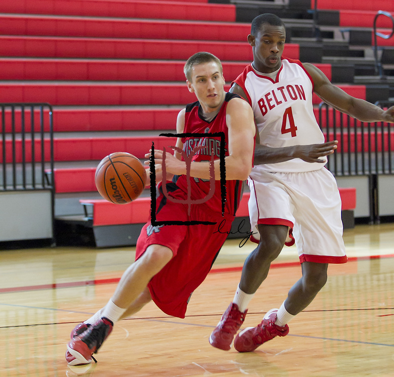 Vista Ridge's Bradley Piper drives around Belton's Kyle Battle Friday during the Leander ISD Tournament.  The Rangers beat Belton 63-46 Saturday.