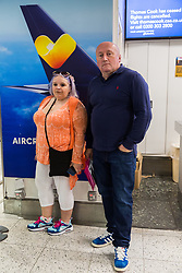 Bricklayer Martin  Nowell, 53 and partner PixieFlgeul, 48, whose holiday plans in Hurghada, Egypt are now in tatters as travel company Thomas Cook has ceased trading after failing to come to a deal with its bankers and creditors, leaving tens of thousands of travellers unable to depart on their holidays from South Terminal at Gatwick Airport, and a massive repatriation exercise to return holidaymakers from destinations all over the world. London Gatwick Airport, September 23 2019.