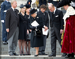 © London News Pictures.17/04/2013. London, UK.  HRH Queen Elizabeth II and Price Philip walk past Mark Thatcher, Sarah Thatcher and Carol Thatcher as they leave St Paul's Cathedral in London following the funeral of former British Prime Minister Margaret Thatcher on April 17, 2013. Photo credit : Ben Cawthra/LNP