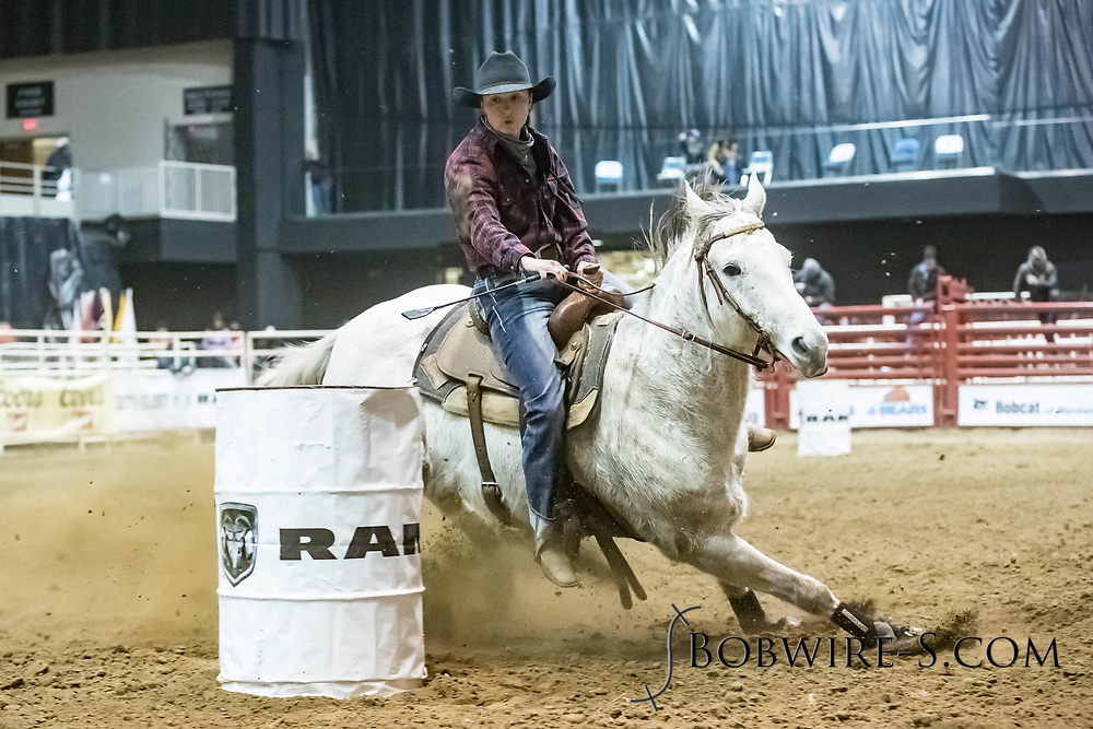 Barrel racer Tess Dolezal makes her run during slack at the Bismarck Rodeo on Saturday, Feb. 3, 2018. She had a time of 13.74 seconds. This photo and more from most runs are available at Bobwire-S.com.