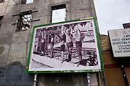 Roma 9 Settembre 2013 <br /> Un manifesto con una gigantografia dell'immagine di piazzale Loreto a Milano: l'istantanea che ritraeva, al centro, i corpi di Mussolini e Claretta Petacci, uccisi dai partigiani. La foto compare - affissa su un pannello da manifesti pubblicitari - rovesciata. E' stata appesa all'edificio che dovrebbe ospitare la Casa della Memoria al Quartiere San Lorenzo