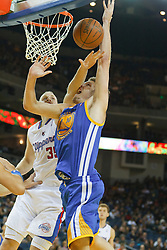 October 29, 2010; Oakland, CA, USA;  Los Angeles Clippers center Chris Kaman (35) fouls Golden State Warriors center David Lee (10) on a shot during the third quarter at Oracle Arena. The Warriors defeated the Clippers 109-91.
