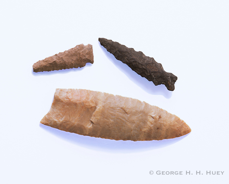0210-1041 ~ Copyright: Copyright: George H. H. Huey ~ Large Paleo-Indian point and smaller points used by Archaic people. New Mexico.
