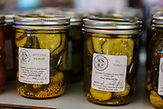 Locally canned Pickles on display at the Farmers Market along Main Street in downtown Greenville, South Carolina.