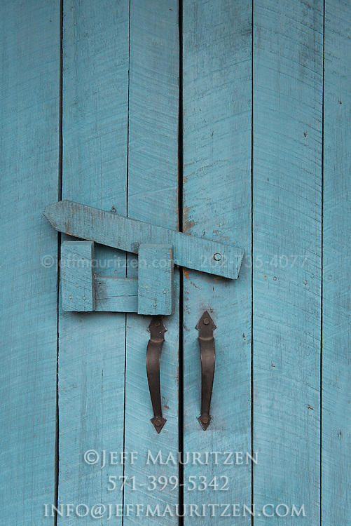 Blue wooden doors on a hacienda.