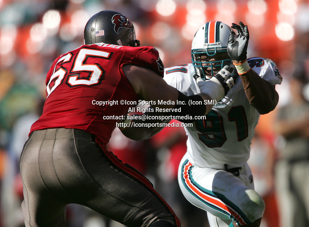 15 NOV 2009:  Buccaneer tackle Jeremy Trueblood (65) attempts to keep Cameron Wake (91) of the Dolphins out of the backfield during the game between the Tampa Bay Buccaneers and the Miami Dolphins at Landshark Stadium in Miami Gardens, FL.  The Dolphins defeated the Buccaneers by the score of 25 to 23.