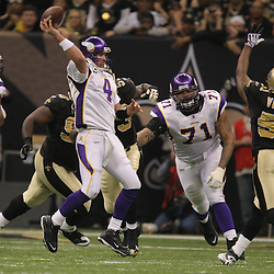 Jan 24, 2010; New Orleans, LA, USA; Minnesota Vikings quarterback Brett Favre (4) is pressured by New Orleans Saints defensive end Bobby McCray (93) during a 31-28 overtime victory by the New Orleans Saints over the Minnesota Vikings in the 2010 NFC Championship game at the Louisiana Superdome. Mandatory Credit: Derick E. Hingle-US PRESSWIRE