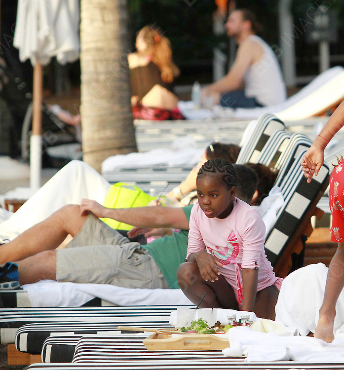 18.NOVEMBER.2012. MIAMI<br /> <br /> MADONNA'S ADOPTED CHILDREN DAVID BANDA AND MERCY JAMES ENJOY A DAY POOLSIDE IN MIAMI WITH THEIR NANNY, WHILST MADONNA IS ON HER WORLD TOUR.<br /> <br /> BYLINE: EDBIMAGEARCHIVE.CO.UK<br /> <br /> *THIS IMAGE IS STRICTLY FOR UK NEWSPAPERS AND MAGAZINES ONLY*<br /> *FOR WORLD WIDE SALES AND WEB USE PLEASE CONTACT EDBIMAGEARCHIVE - 0208 954 5968*
