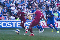 Football - 2018 / 2019 Premier League - Cardiff City v Liverpool<br /> <br /> James Milner of Liverpool scores his team's second goal from a penalty , at Cardiff City Stadium.<br /> <br /> COLORSPORT/WINSTON BYNORTH