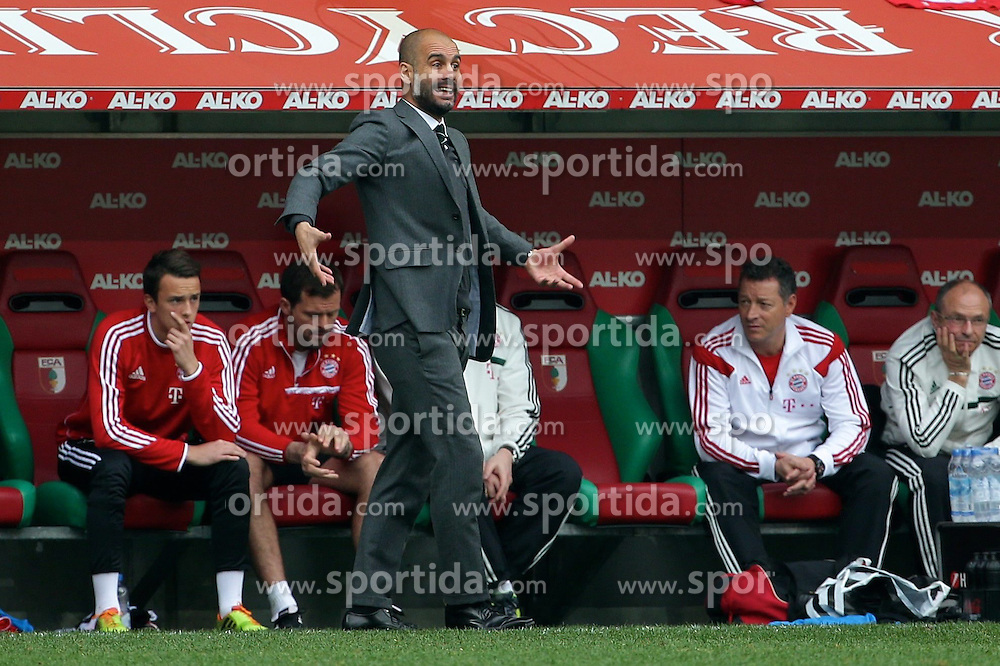 05.04.2014, SGL Arena, Augsburg, GER, 1. FBL, FC Augsburg vs FC Bayern Muenchen, 29. Runde, im Bild Trainer Josep Guardiola (Bayern Muenchen) gibt lautstark Anweisungen // during the German Bundesliga 29th round match between FC Augsburg and FC Bayern Munich at the SGL Arena in Augsburg, Germany on 2014/04/05. EXPA Pictures &copy; 2014, PhotoCredit: EXPA/ Eibner-Pressefoto/ Fastl<br /> <br /> *****ATTENTION - OUT of GER*****
